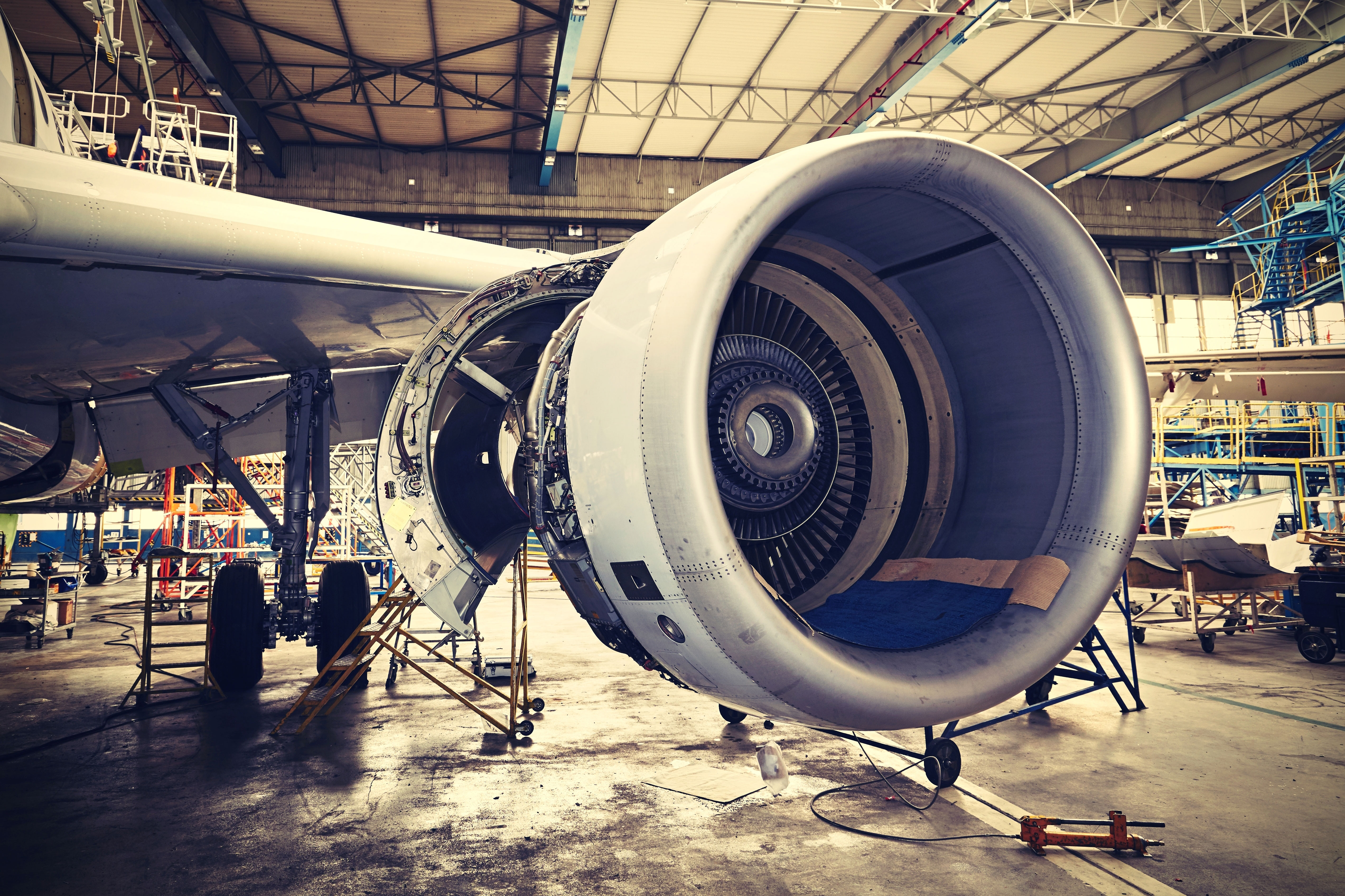 Aerospace & Defense parts | Airplane engine undergoing heavy maintenance