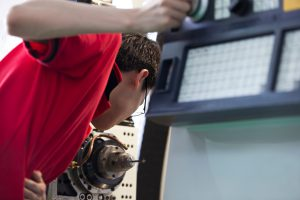 Engineer conducting quality inspection during machining