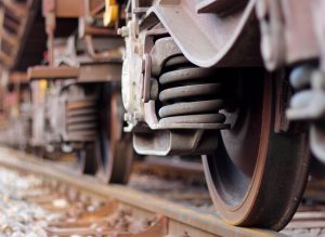 Acme OEM Transportation parts | Close-up of train wheels on a track
